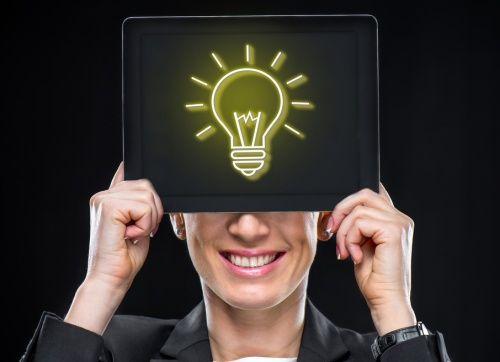 new idea for SEO - woman with lightbulb